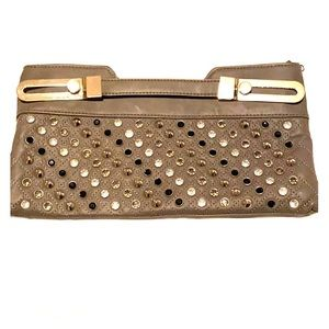 A jeweled and studded soft gray clutch.